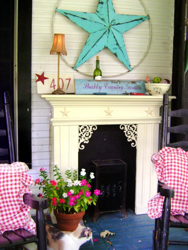 A variety of flea market finds were given new life in this shabby chic porch by Rate My Space contributor  vanillacandle. The overall affect is an inviting and comfortable. Giving new uses to old things is the most exciting part of shabby chic decorating. An old fireplace on a porch? There are no rules with shabby chic!