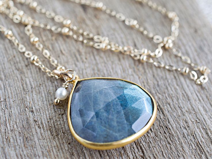 A personal favorite from my Etsy shop https://www.etsy.com/listing/229205354/labradorite-pendant-necklace-gold