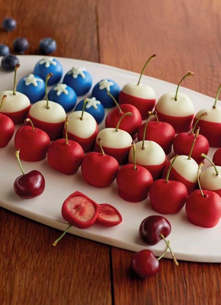 Chocolate covered cherries and blueberries in the style of the American flag. Perfect for Memorial Day Weekend and 4th of July parties.