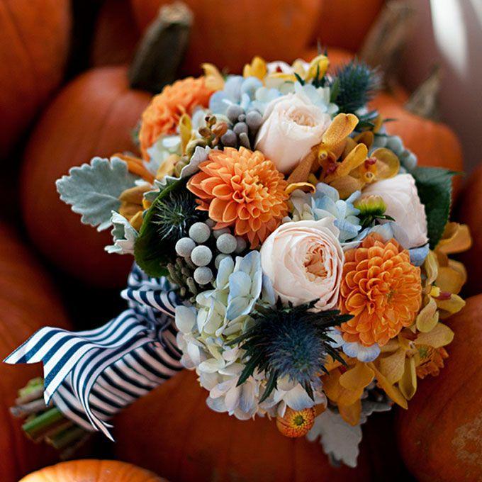 Brides.com: . Arrangement of hydrangeas, thistles, silver brunia, dahlias, mokara orchids, garden roses, and dusty miller. Bouquet by Hana Floral Design