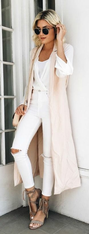 neutral outfit with long vest and white denim