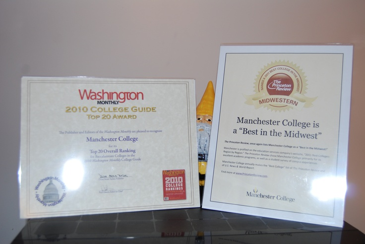 Wow, that's a lot of recognition! Kevin the Gnome is impressed by 2 of the many awards Manchester has won from national media.
