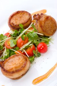 Bay Scallops and Applewood Bacon with Port Reduction - Whether you are simply looking to try something different for dinner or having a special dinner date, this recipe is easy and sure to please. It is great served with some greens and/or with a baked butternut squash topped with nutmeg, cinnamon, and butter.