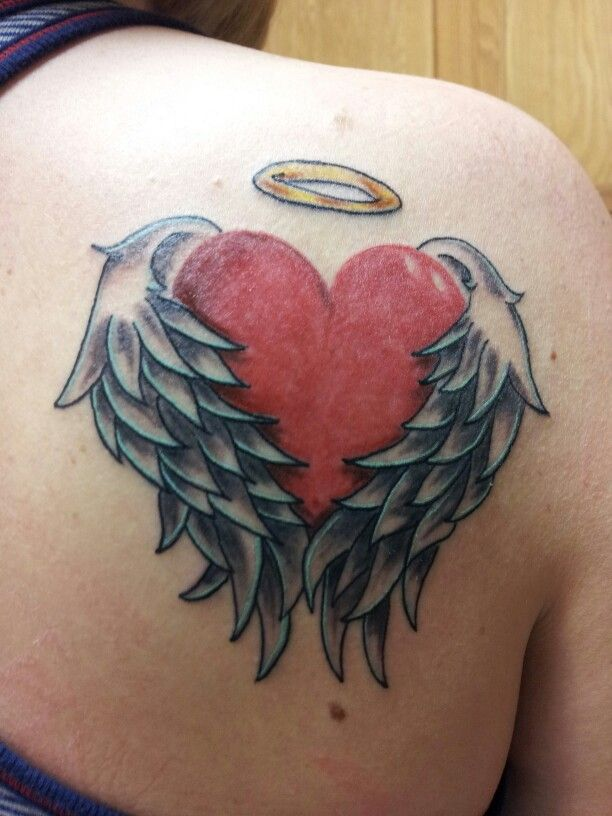 Heart with wings tattoo - maybe put princess crown in there.  (not as big)