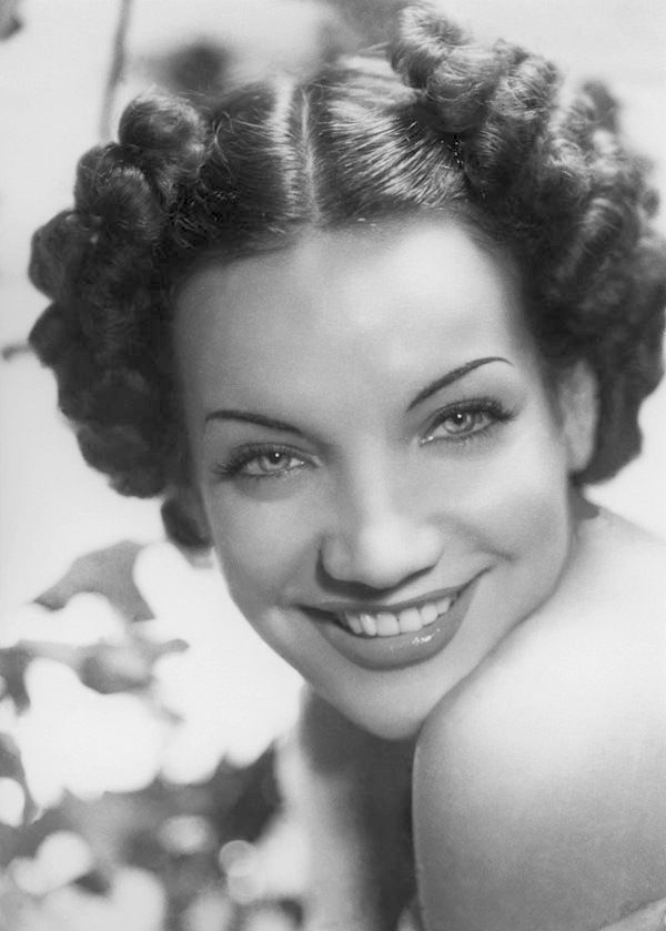 1940s fashion... Carmen Miranda, WITHOUT her outrageous hat or costume.  ***DID YOU KNOW*** Carmen was born in Portugal and raised in Brazil and was  MILLINER, hence the amazing hats she is known for.