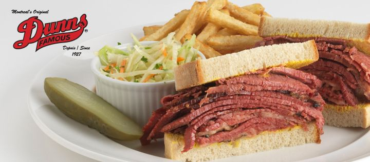 """""""Dunn's Famous"""" is a truly loved Quebec institution founded in 1927 by Meyer Dunn. It uses traditional recipes that include unique brine, proprietary light rye sourdough bread and always hand sliced, prepared to order, your-choice-of lean to fat, triple A beef brisket."""
