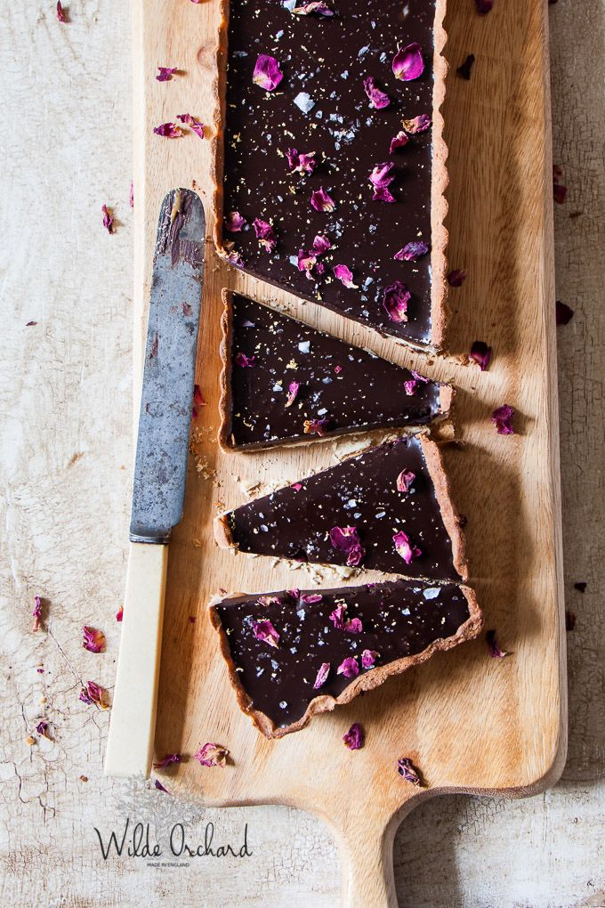 The creamiest no bake chocolate tart ever! Chocolate ganache with sea salted caramel and rose petals for the pretty factor. Super easy and impressive.