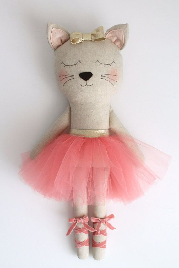 ♥ Who doesnt love a sleepy cat in a tutu? ♥ This cute cat ballerina was made to bring some sparkling magic to a little girls life! She makes the most gorgeous birthday gift and its a great doll to decorate a nursery or kids room. - The ballerinas body is made with a linen cotton blend fabric and stuffed with fiberfill. - The tutu is made with coral tulle and a golden bias tape. The legs are accented with a velvet ribbon. - The bow is sewn to the cats head and the face is machine…