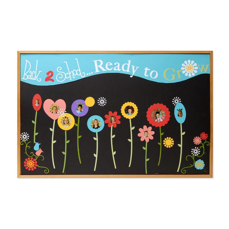 """""""Back 2 School ... Ready to Grow!"""" is a fun title for a bulletin board display at the beginning of the year.  I like how the teacher has taken pictures of students for the center areas of each flower."""