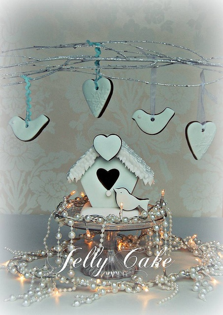 A pretty ice blue gingerbread bird house with matching tree cookies.Gingerbread Birds, Christmas Cookies, Ice Blue, Blue Gingerbread, Blue Christmas, Birds House, Gingerbread House, Gingerbread Birdhouses, Christmas Gingerbread