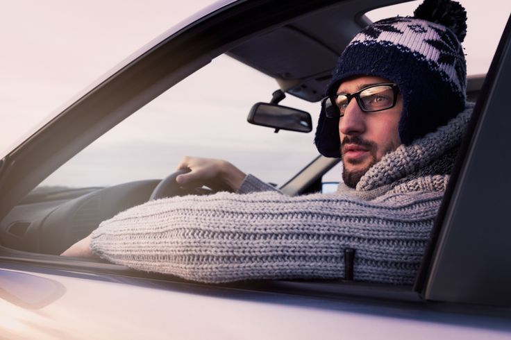 Young man driver, portrait, winter