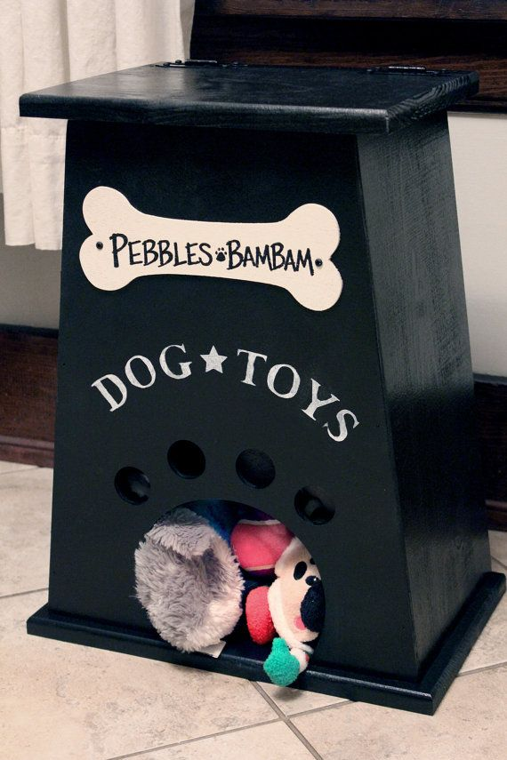 Dog Toy Box by CollegeViewCrafts on Etsy, $35.00.. Great idea, we just have a decorative box that the pups tip over to get their toys.