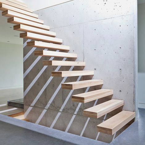 Floating wood and concrete stair.