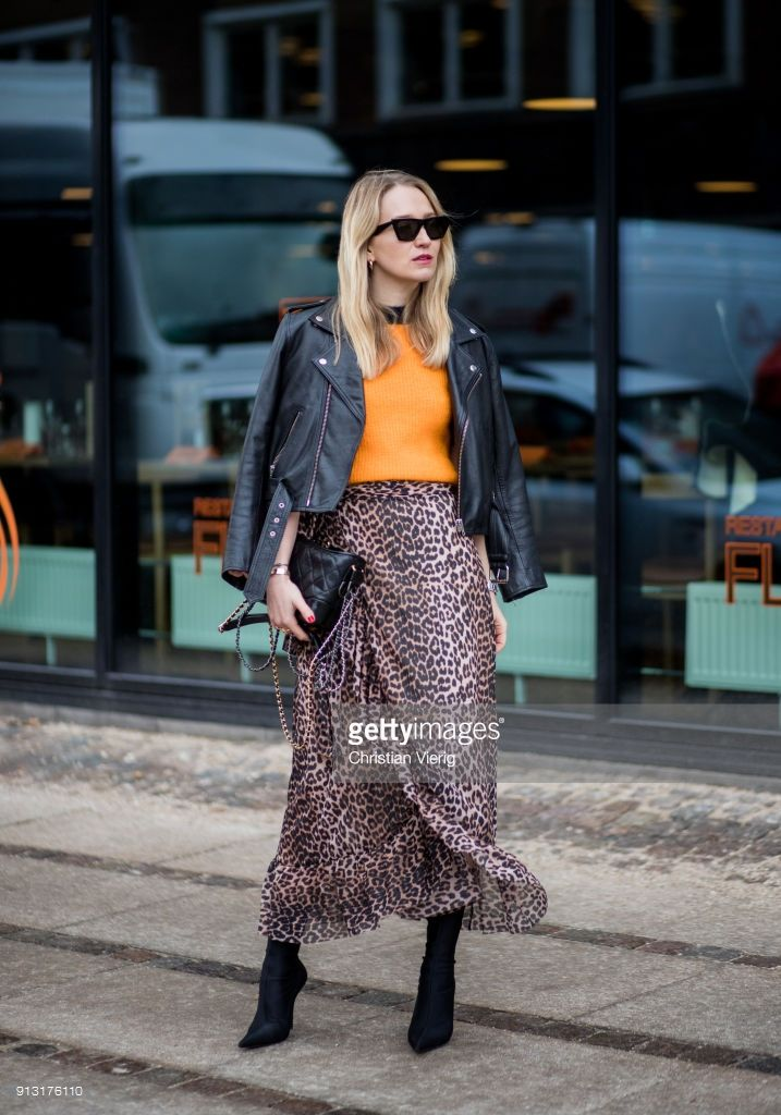 8233791d98d Juliane Diesner wearing Ganni leopard print skirt, black leather jacket  Ganni, Chanel bag, Balenciaga boots during the Copenhagen Fashion Week  Autumn/Winter ...