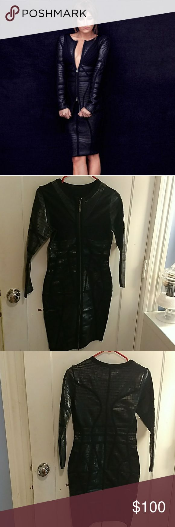Black faux leather bodycon dress A sexy front zipped long sleeve bandage dress in black. The dress features a snakeskin inspired texture that works to conceal bulges and faux leather?adds edginess to your look. The fabric of the dress is strong and sturdy so it shapes your body and defines your curves. It's anti-Static, Anti-Wrinkle. Bought this dress and after months of not wearing it decided to put it but I have a really big chest and when I put it in it ripped as seen on picture. Never…