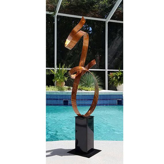 Title: Copper Allure Dimensions: 48 x 17 x 12 including the 12 base (121.92 cm x 43.18 cm x 30.48 cm) Color: Copper This unique eye-catching, breath-taking free-standing sculpture is a spectacular architectural feature to add distinctive modern style to your landscape, and a stunning focal point for your home or office. Creatively designed and built for dynamic indoor or all-seasons outdoor display. My signature-defined hand textured intricacies and carvings into the metal capture and…