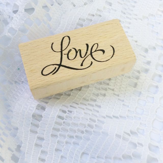 """Update: last unit left! Affordable rubber stamps that are the staple for all crafters! They're a good investment because you can use them over and over again! They also make a cute accent on gift wraps and hand-made cards/notes! Use them on colourful ink pads for double the fun! This stamp features beautiful calligraphy of the word """"Love"""". Perfect for stamping gift tags/bags and cards before signing off! Use to accent your scrapbook as well!- Size: 6 cm x 3 cm x 2 cm. - Condition: Brand…"""