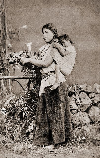 Mexican woman with child in baby sling by ookami_dou, via Flickr
