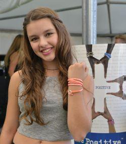 Fatima Ptceck wearing a We Positive bracelet