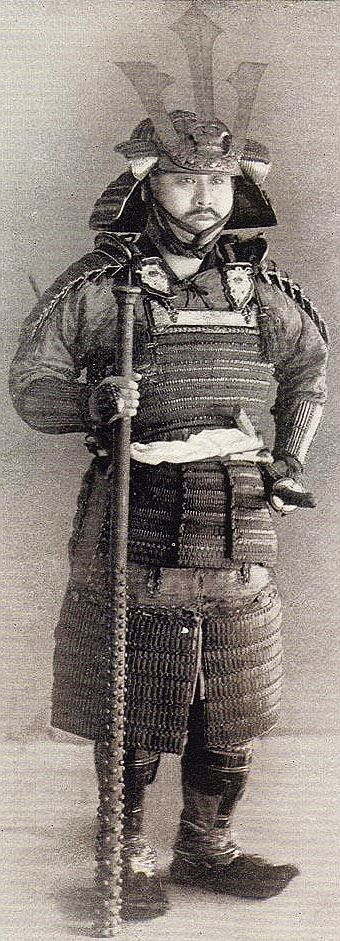 Samurai holding a kanabo (a two-handed battle mace)