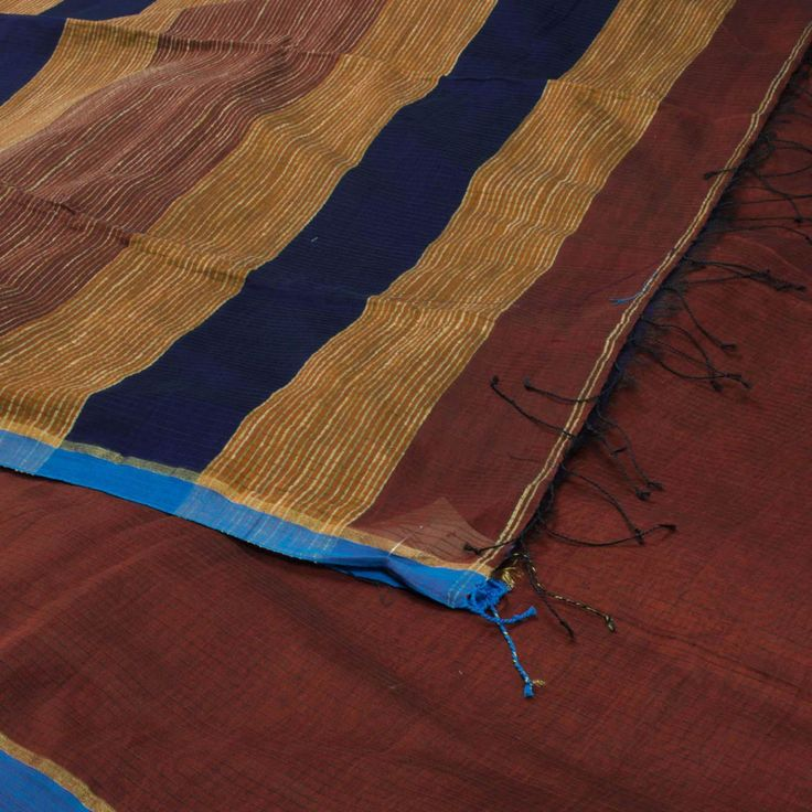"The ""#Brown"" #handwoven #Khadi #Silk #Cotton #Sari from Ssaha is woven with stripes all over the body that is set off by a blue border on either side. Attractive beige, brown and blue stripes adorn the pallu. The border is repeated on the navy blue blouse that completes the sari."