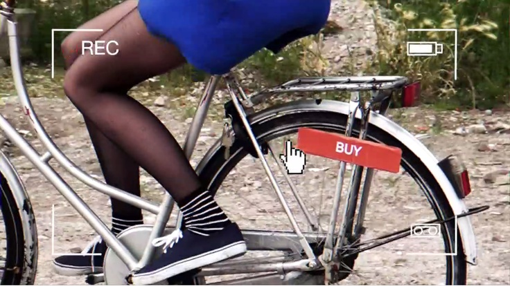 Add depth to your classifieds ads with video material. I think this second hand bicycle would be worth my money because I've seen a video of someone riding it. I love how the bright color of her dress sets off the icy whiteness of the wheel rims.