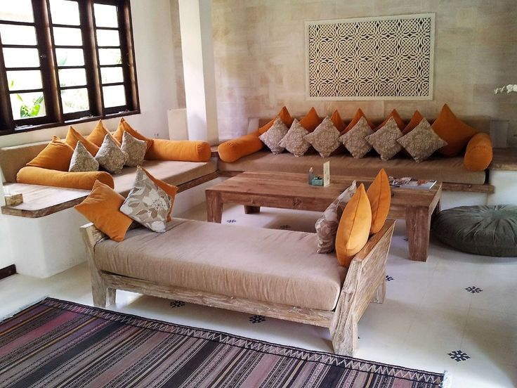 BEACH WOODEN Living-Room by Canela Bali.  Beach bungalow inspired living-room set with light-colored wood and orange soft furniture with covers fully detachable to facilitate the washing. Get yours https://www.canelabali.com/canelabaliliving-room