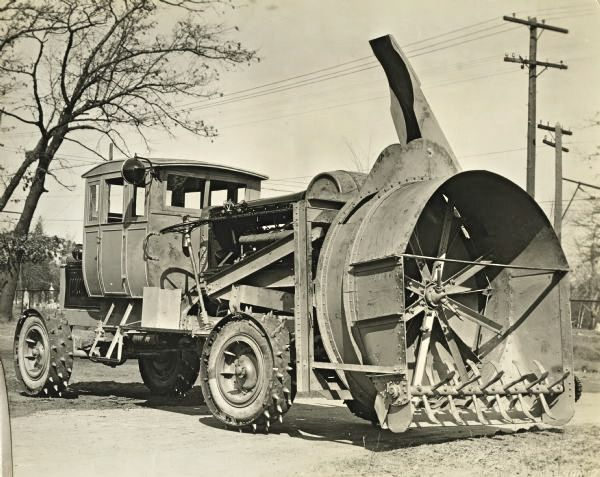 One VERY old snow blower.