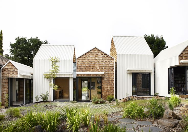 "S+P and their 8 year old twin sons asked for a home ""for community, art and nature to come together"". We designed them a village. WHAT? Tower House is a renovation and extension to a weatherboard home in Alphington, Victo-ria, Australia. We re"
