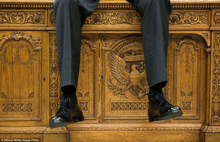 October 1, 2015. 'I focused on the detail of the Resolute Desk as the president was talking with two aides in the Oval Office'