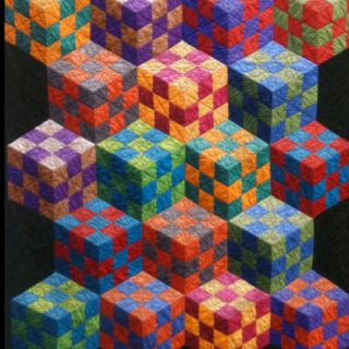"""My aunt's ""fun with cubes"" quilt"" ...  [Note: as originally pinned by Holly Katzer] pinterestfor iPhone.com"