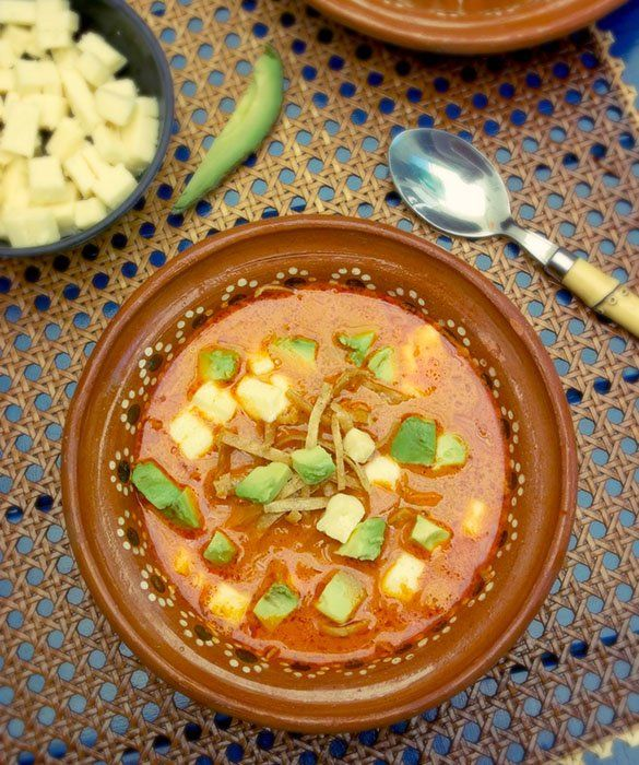 Sopa Azteca is a chicken soup-based dish that also calls for chiles and crema Mexicana. Don't forget to garnish the soup with avocado, queso fresco and fried or baked tortilla strips. Great to serve for Day of the Dead! Recipe by @leslie_limon.