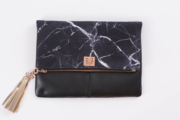 Clutch+Bag+Marble+Affair+-+Bold,+classy+and+fashion+forward+the+range+is+inspired+by+the+Edgy+London+look+and+plays+on+texture+and+contrast.+Simple+and+classy+pieces,+encompassing+the+modern+elegant+women+inside+us.+Distinctive+fashion+accessories.#marble #clutch #clutchbags #fashion #accessories #friends #party #metallic #handbags #giftideasformum #mum
