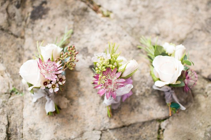 White rose bud and pink wild flower button holes. Photography by Bowtie and Belle