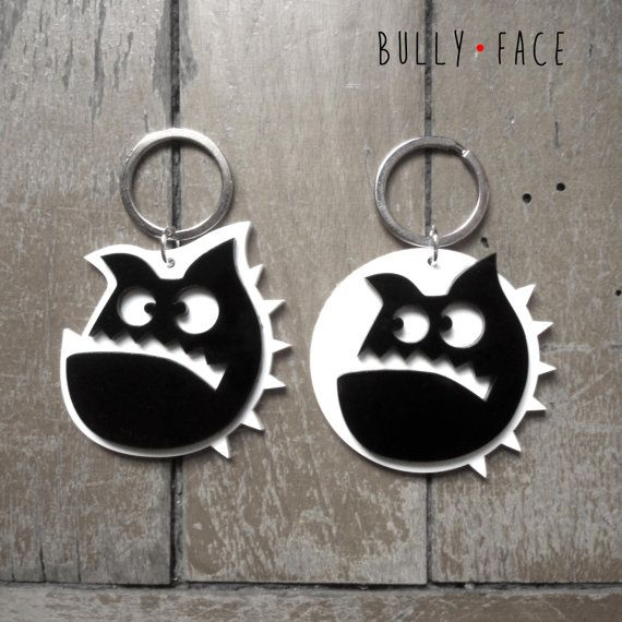 Key holder with funny bulldog face made of black and white methacrylate
