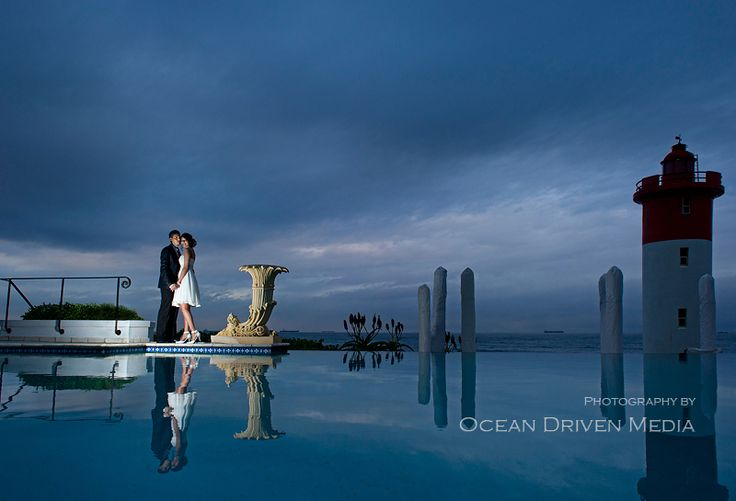 Indian bridal couple at The Oyster Box with Umhlanga Lighthouse in background