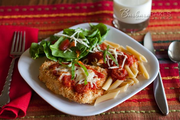 A lighter Chicken Parmesan recipe. Instead of frying the chicken cutlets in lots of oil, they're baked so they're crispy and cheesy, but also healthy and delicious.