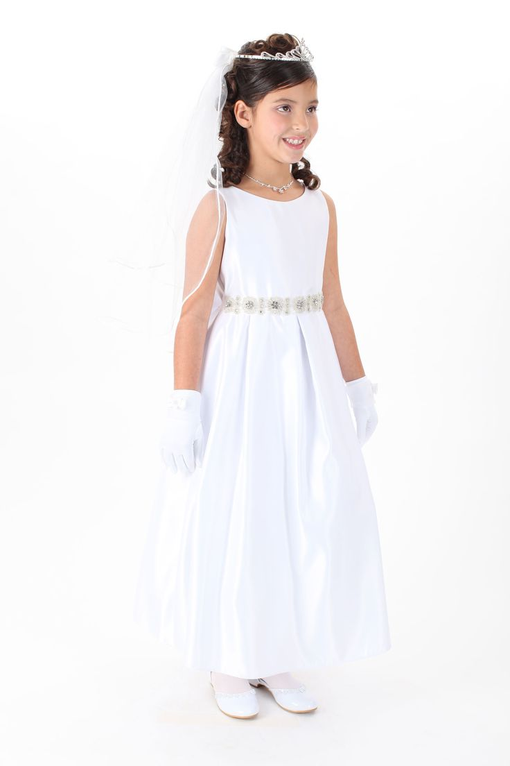 This satin sleeveless style features an intricately beaded floral waistband that screams detail!  If that was not enough to make you fall in love with this dress, the fun and oversized bow with the same beaded detail surely will.  Additional netting underneath adds to a fuller look. Zipper closure with  sash that ties. The dress is fully lined for complete coverage to ensure that your princess stays comfortable.