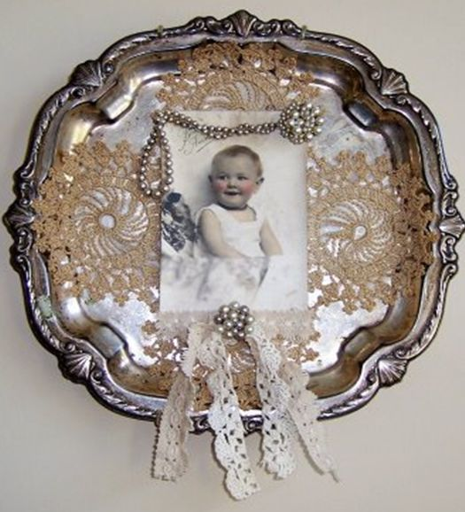 Frame it in Silver: An old silver tray, vintage doilies, old photo, jewelry and trim - creates a pretty display. Never use original old photos in craft projects: They are often one of a kind, and will fade over time when exposed to light. Use scanned copies (Easy with Pic Scanner app for iPhone & iPad - Click to download free.)