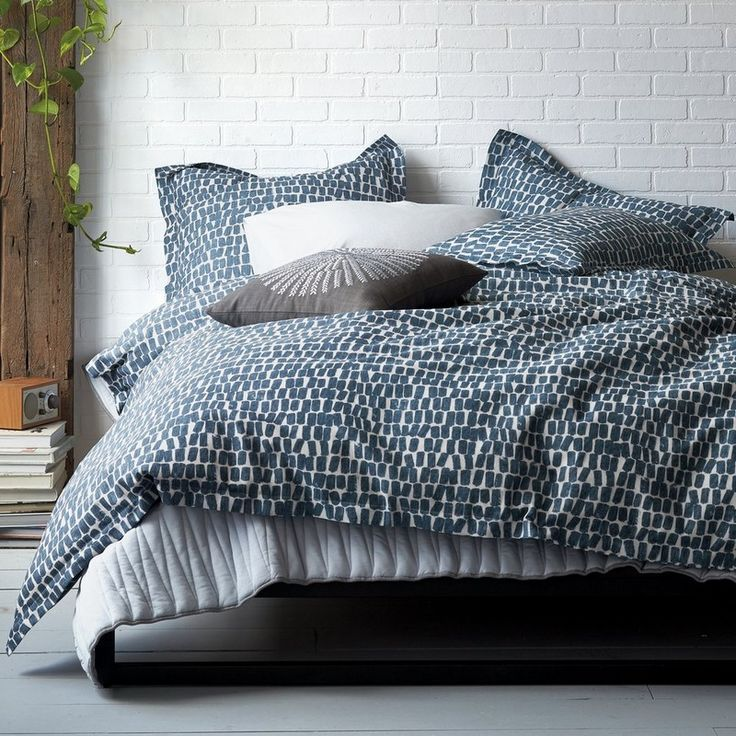 "domino By The Company Store® Randall Bedding – Rows of hand-painted ""lozenges"" are intentionally imperfect on this artful bedding, bringing character to the bed. Hued in navy on cream. This contemporary duvet cover and sham are woven of pure, slubbed cotton for rich natural texture."