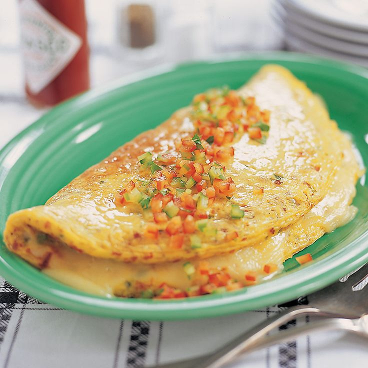 Make our Family-Style Denver Omelet for your next Sunday breakfast. We sauté ham steak, peppers, and onions in butter and stuff the omelet with melty monterey jack cheese.
