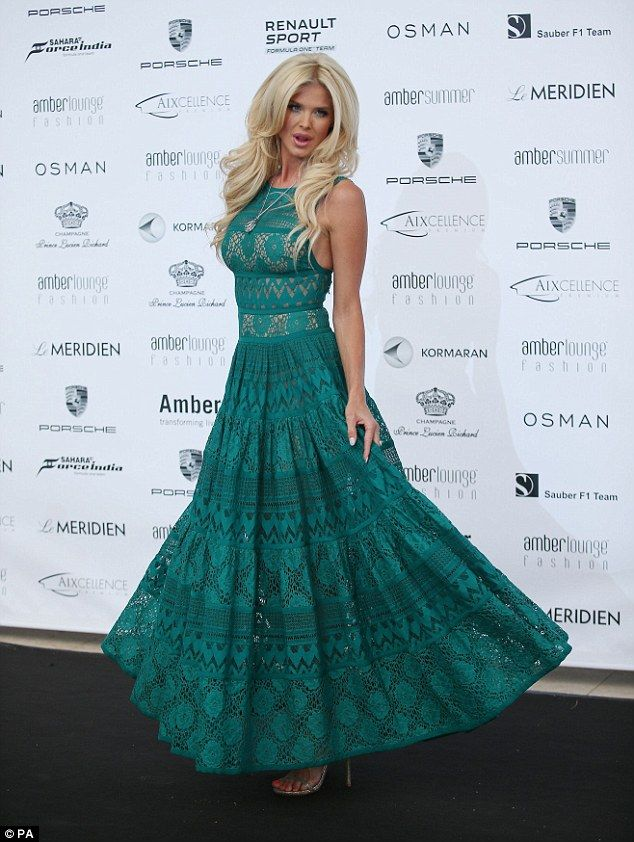 Showstopper: Victoria Silvstedt stunned in elegant, jade coloured gown at the Amber Lounge fashion show in Monaco on Friday