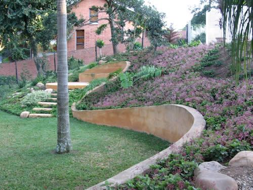 Curved retaining wall hints of a cinder block wall that - How to stucco exterior cinder block walls ...