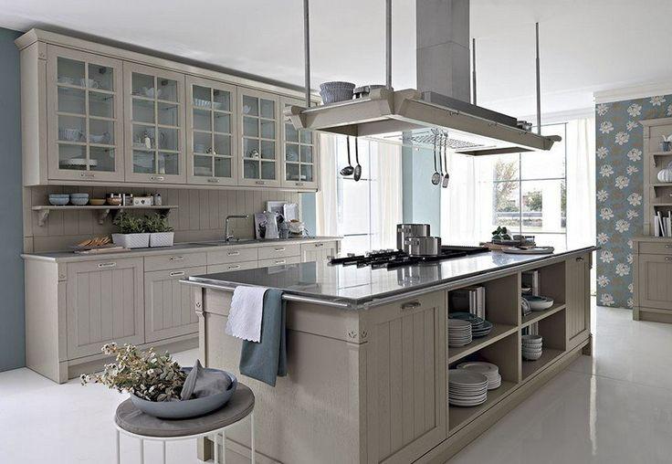 aménagement de cuisine de style méditerranéen avec armoire de rangement et hotte aspirante