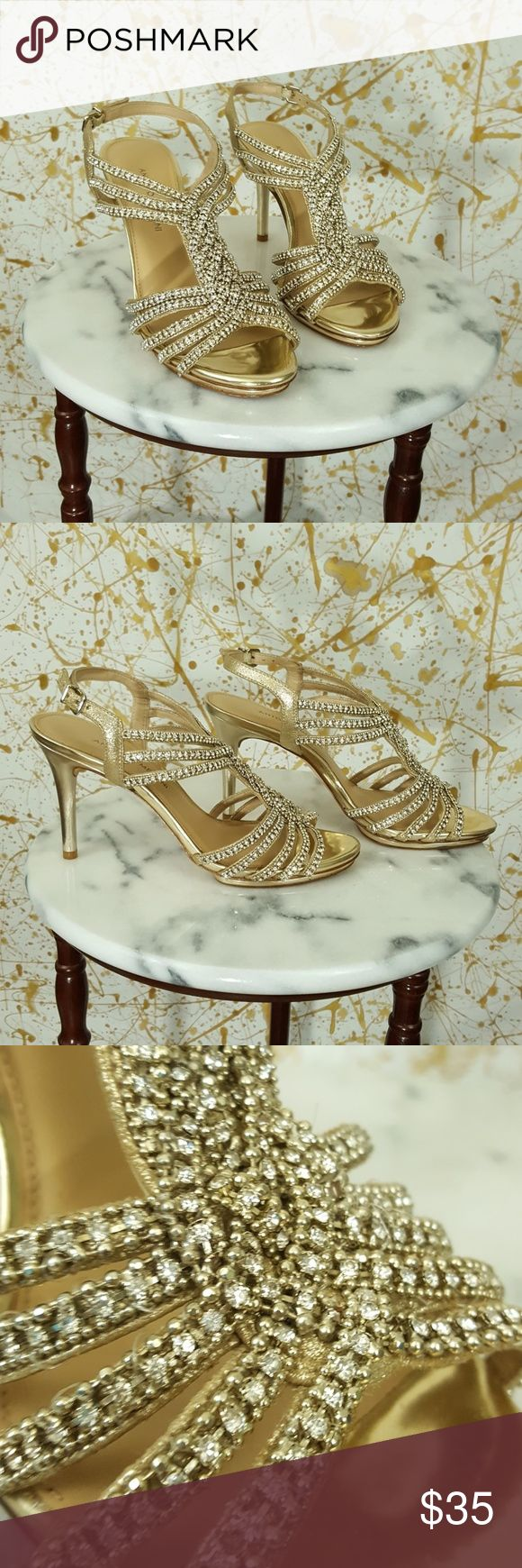 """Antonio Melani Gold Jeweled Open toe Heels 9.5 Hey gorgeous, thank you for checking out my closet. This is a pair of Antonio Melani Gold Jeweled Open toe Heels size 9.5. There is wear and water marks on the bottom of the shoes. There are small Knicks on the heels. The strap is adjustable and the heels are approximately 4"""". All the embellishments are intact. Please feel free to ask any questions. ANTONIO MELANI Shoes Heels"""