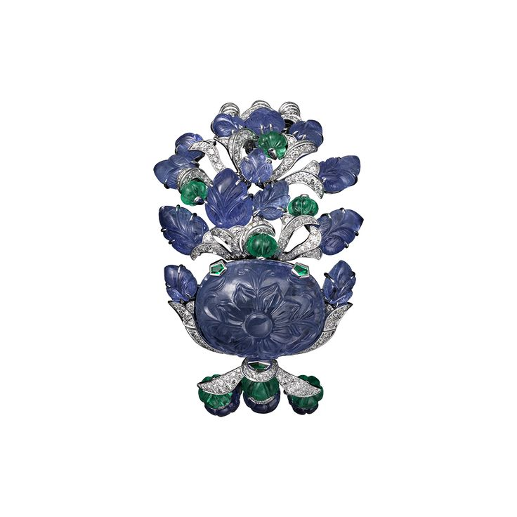 Platinum, one 75.37-carat carved sapphire, melon-cut sapphire and emerald beads, sapphire carved leaves, brilliants.