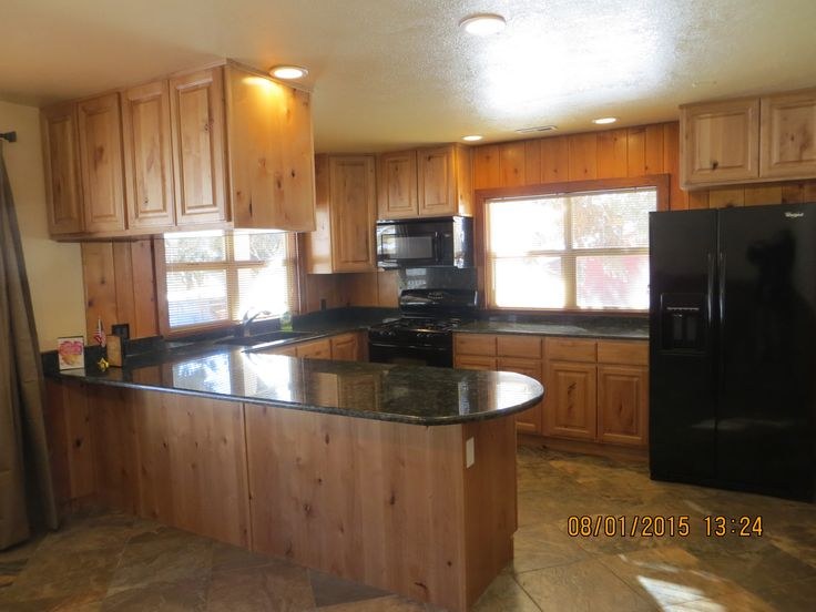 Natural stain knotty alder kitchen cabinets gold tile backsplash dark granite counter top kitchendesign cabinets kitchen and laundry room