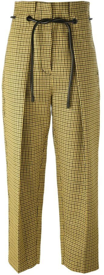3.1 Phillip Lim origami pleat houndstooth trousers  Details: Yellow wool origami pleat houndstooth trousers featuring a high rise, a concealed front fastening, side pockets, creases, a rear flap pocket and a slim black tie-belt.