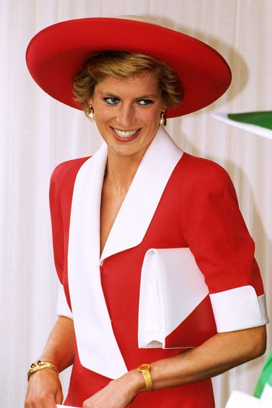Princess Diana at The Garter Ceremony in Windsor wearing a bright red dress by Catherine Walker & a large hat by Philip Somerville. June 1990.: