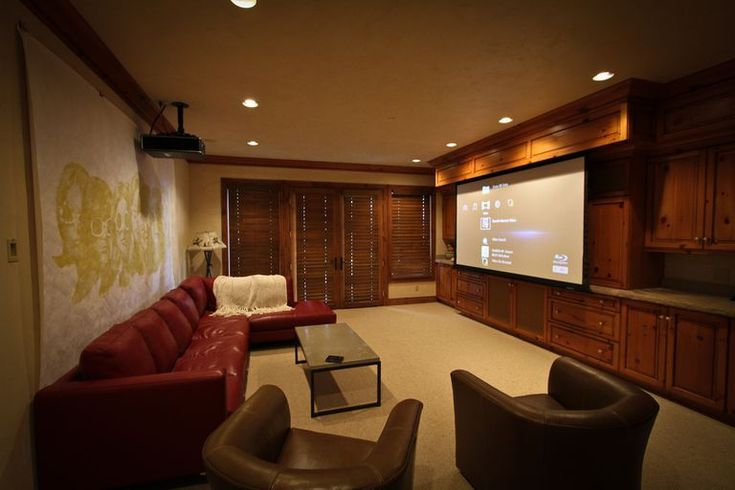 A home theatre with a projection screen